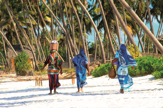 zanzibar women on sandy beach