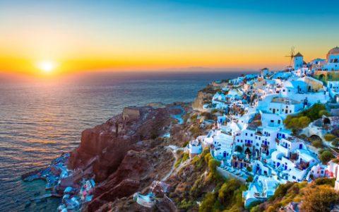 Traditional Greek village Oia (Ia) on Santorini island in dusk, Cyclades, Greece.