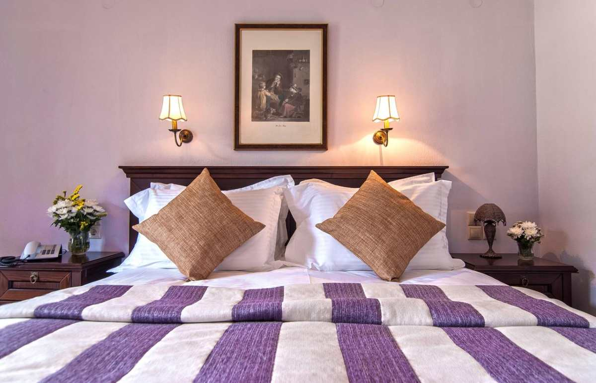 Hotel Doupiani House κρεβάτι στα Μετέωρα