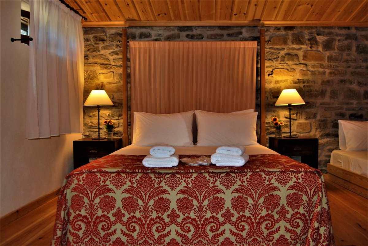 Κρεβάτι δίκλινου στο Rodia Boutique Hotel, Κήποι, Ζαγόρι